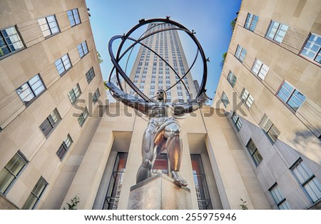 NEW YORK CITY, NY - OCT 30: Atlas statue and Rockefeller Center on October 30, 2014 in New York City. Rockefeller Center is a complex of 19 commercial buildings located in Midtown Manhattan. - stock photo