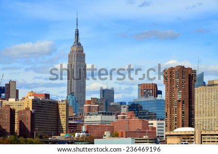 NEW YORK CITY, NY OCT 29: Midtown and the Empire State Building on Oct. 29, 2013 in New York City. Empire State Building is a 102-story landmark. It was world's tallest building for more than 40 years - stock photo