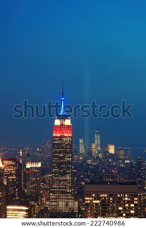NEW YORK CITY, NY - SEP 11: Empire State Building with tribute on September 11, 2013 in New York City. It is a 102-story landmark and was world's tallest building for more than 40 years. - stock photo
