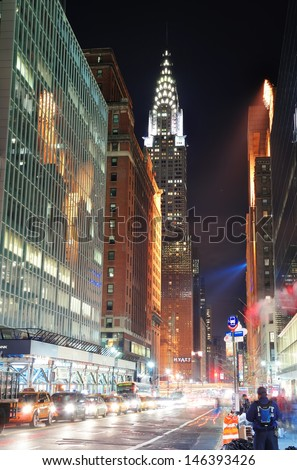 NEW YORK CITY, NY, USA - DEC 30: Chrysler Building at night with street on December 30, 2011, New York City. It was designed by architect William Van Alena as Art Deco architecture in US. - stock photo