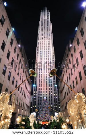 NEW YORK CITY, NY, USA - DEC 30: Rockefeller Center at night on December 30, 2011, New York City. It was built by the Rockefeller family in 1939 and was declared a National Historic Landmark in 1987. - stock photo