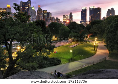 New York City, NY, USA - July 15 2010: Central Park at dawn, surrounded by skyscraper, Manhattan - stock photo
