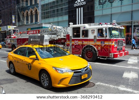 NEW YORK CITY, NY, USA - JULY 07, 2015: Rare image of overlay with FDNY firetruck and yellow cab in Manhattan. The taxicabs and FDNY of New York City are widely recognized icons of the city. - stock photo