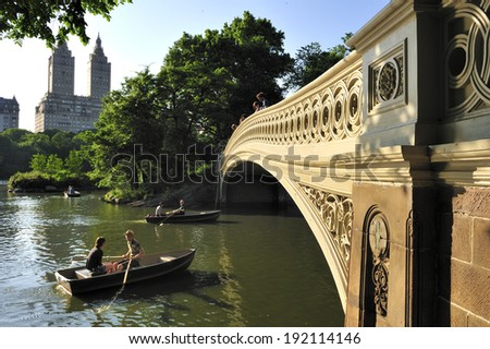 New York City, NY, USA - June 14 2010: The Bow Bridge, a cast iron bridge located in Central Park, crossing over The Lake  - stock photo