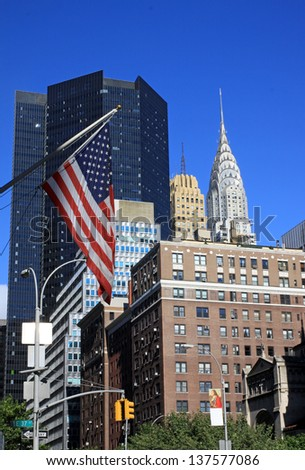 NEW YORK CITY, NY, USA - OCTOBER 12: Chrysler Building in the day with street on October 12, 2012, New York City. It was designed by architect William Van Alena as Art Deco architecture in US.  - stock photo