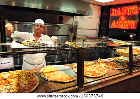 NEW YORK CITY - OCT 11: Pizzeria restaurant on Oct 11 2009 in Manhattan New York. About 5,000,000 pounds of Pizza is consumed in the Untied States alone in one day. - stock photo
