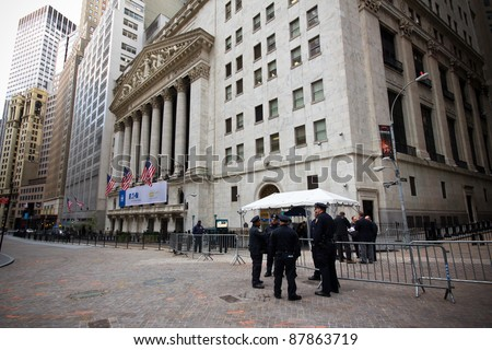 NEW YORK CITY - OCT. 21:  Police officers gather at barricade on Wall St. on October 21, 2011 in NYC.  The Financial District has been the epicenter of the Occupy Wall St. Protests since Sept 2011. - stock photo