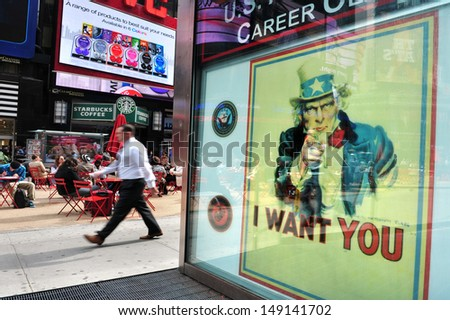 "NEW YORK CITY - OCT 11 2010:Poster of Uncle Same reads ""I WANT YOU"" on the US Army recruit center in Times Square. Less than 30% of Americans between 17 to 23 are qualified for military service. - stock photo"