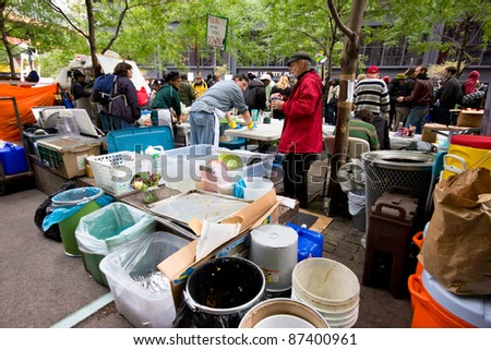 NEW YORK CITY - OCT. 21:  Protesters organize soup kitchen at Occupy Wall Street demonstration in NYC's Zuccotti Park on Oct 21, 2011.  The protest began on Sept 17. - stock photo