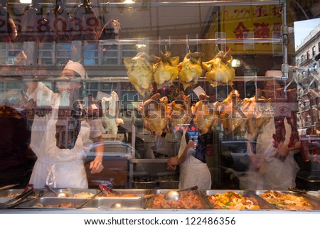 NEW YORK CITY - OCT 14: Restaurant window in Chinatown NYC on Oct 14, 2012. Chinatown is a busy cultural district with one of the largest concentrations of Chinese people in the Western Hemisphere - stock photo