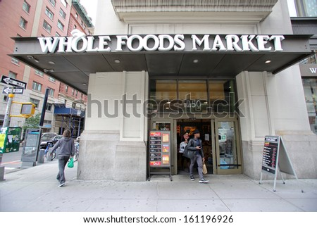 NEW YORK CITY - OCT 23 2013: Shoppers enter a Whole Foods Market supermarket in Manhattan on Wednesday, October 23, 2013. Whole Foods Market, Inc. is an American foods supermarket chain - stock photo