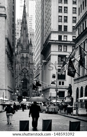 NEW YORK CITY - OCT 09 2009:Trinity Church as view from Wall Street. During the September 11, 2001 attacks, people took refuge from the massive debris cloud inside the church. - stock photo