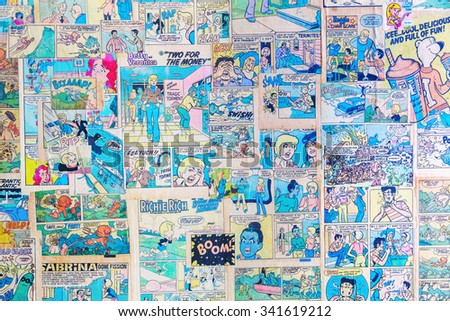 NEW YORK CITY - OCTOBER 10, 2015: antique comics used as wallpaper in a restaurant. Comics had a lowbrow reputation for much of history,  at end of the 20th century began they find greater acceptance  - stock photo