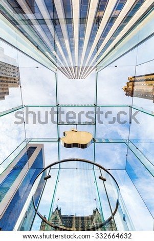 NEW YORK CITY - OCTOBER 14, 2015: Apple won numerous architectural awards for store design, particularly for this store on 5th Ave, Midtown, whose glass cube was designed by Bohlin Cywinski Jackson - stock photo