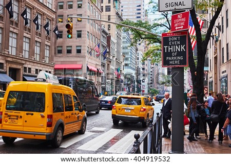 NEW YORK CITY - OCTOBER  16, 2014: Don't even think of parking here sign on the corner of 5th Avenue and W 50th Street - stock photo