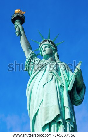 NEW YORK CITY - OCTOBER 13, 2015: Liberty Statue in NYC. It is a colossal neoclassical sculpture on Liberty Island, designed by Frederic Auguste Bartholdi, built by Gustave Eiffel and dedicated 1886 - stock photo
