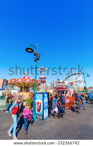 NEW YORK CITY - OCTOBER 11, 2015: Luna Park with unidentified people. Its an amusement park in Coney Island opened on May 29, 2010 at the former site of Astroland, named after original park from 1903 - stock photo
