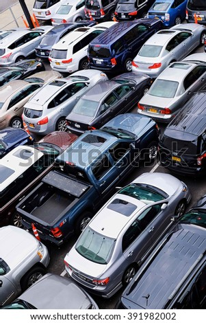 NEW YORK CITY - OCTOBER 7, 2014: Manhattan parking lot, in the Chelsea area near the High Line, with many cars parked bumper to bumper