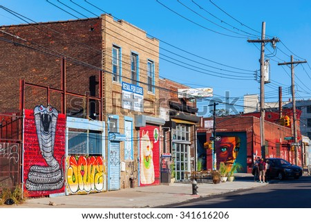 NEW YORK CITY - OCTOBER 10, 2015: mural art in Bushwick, Brooklyn, with unidentified people. Bushwick is one of NYCs major street art hubs, with an outdoor art gallery known as the Bushwick Collective - stock photo