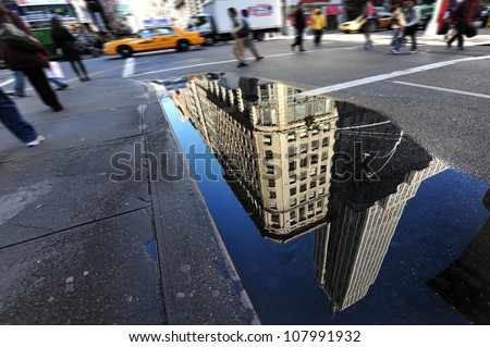 NEW YORK CITY - OCTOBER 14: Reflection of the Empire State Building on October 14, 2009 in New York.The Empire State Building is a 102-story landmark and American cultural icon in New York City. - stock photo