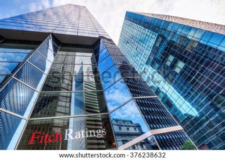 NEW YORK CITY - OCTOBER 08, 2015: skyscraper of Fitch Ratings, that is one of the 3 nationally recognized statistical rating organizations designated by the U.S. Securities and Exchange Commission - stock photo