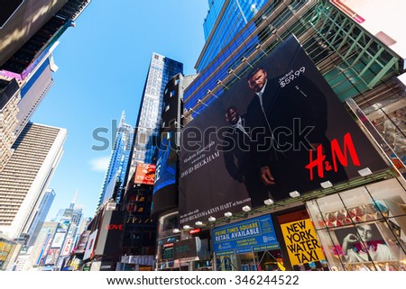 NEW YORK CITY - OCTOBER 06, 2015: skyscraper with billobards at Times Square, Manhattan. It is one of the worlds busiest pedestrian intersections and a major center of worlds entertainment industry - stock photo