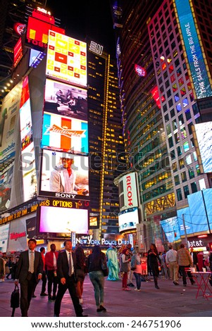 NEW YORK CITY-OCTOBER 9, 2014:Times square in Manhattan.  New York City illuminated colorful  advertising on the buildings at night in the most famous tourist destination in USA