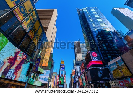 NEW YORK CITY - OCTOBER 06, 2015: Times Square in Manhattan, NYC. It is one of the worlds busiest pedestrian intersections and a major center of worlds entertainment industry - stock photo