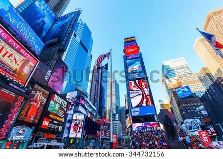 NEW YORK CITY - OCTOBER 13, 2015: Times Square with skyscrapers and neon advertisement. It is one of the worlds busiest pedestrian intersections and a major center of worlds entertainment industry - stock photo