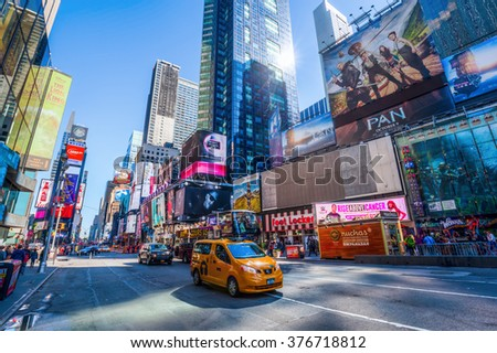 NEW YORK CITY - OCTOBER 10, 2015: Times Square with unidentified people. It is one of the worlds busiest pedestrian intersections and a major center of worlds entertainment industry - stock photo