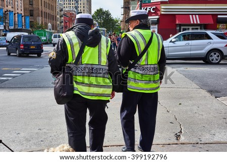 NEW YORK CITY - OCTOBER 10, 2014: Two NYPD crossing guards standing on the corner of E 14th Street and 2nd Avenue in the East Village