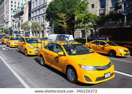 NEW YORK CITY - OCTOBER 07, 2015: yellow cabs in Manhattan, NYC. The taxicabs of New York City are widely recognized icons of the city