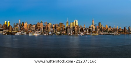 New York City Panorama midtown skyline at dusk over Hudson river - stock photo
