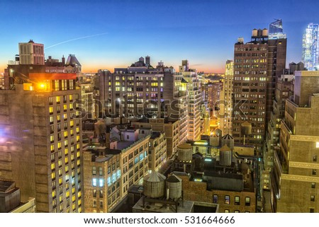 New York City rooftops at dusk
