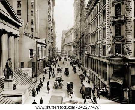 New York City's Wall Street, looking east from the intersection with Broad Street. In foreground left is Federal Hall; on right is J.P. Morgan's bank. Ca. 1910. - stock photo
