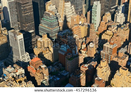 New York City - SEP 11: Empire State Building shadow over urban buildings on September 11, 2015 in New York City. With 8.5M, it is the is the most populous city in the United States. - stock photo