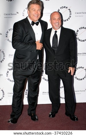 NEW YORK CITY - SEPT 16: Singer Billy Joel(R) and Actor Alec Baldwin(L) arriving at opening night of the NYC philharmonic Sept 16, 2008 in NY. - stock photo