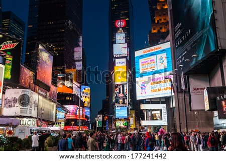 NEW YORK CITY - SEPT 21: Times Square at night with Broadway Theaters and animated LED signs, is a symbol of New York City and the United States, September 21, 2013, Manhattan, New York City, USA. - stock photo