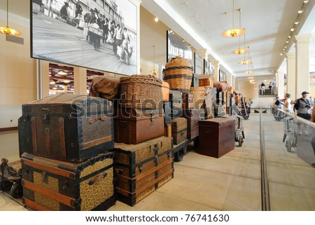 NEW YORK CITY - SEPTEMBER 11: Actual vintage luggage left by some of the millions of immigrants who came through Ellis Island on display at the Ellis Island Museum September 11, 2010 in New York, NY. - stock photo