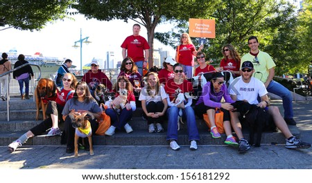 NEW YORK CITY - SEPTEMBER 28 2013: Bestfriends, an animal rescue organization based throughout the US, held its 18th annual fundraising Strut Your Mutt walkathon September 28 2013 in New York City - stock photo
