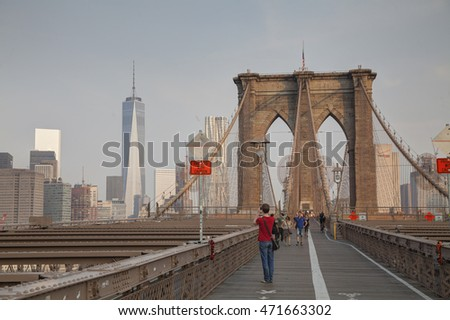 NEW YORK CITY - SEPTEMBER 3: Brooklyn bridge with people on September 3, 2015 in New York City. It's a bridge in New York City and is one of the oldest suspension bridges in the US.