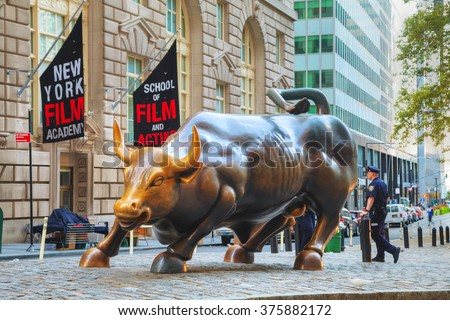 "NEW YORK CITY - September 5: Charging Bull sculpture on September 5, 2015 in New York City. The sculpture is both a popular tourist destination, as well as ""one of the most iconic images of New York""."