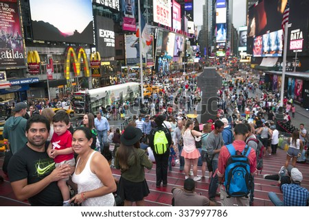 New york city, 12 September 2015: Crowd on Duffy square in New york city near Times square enjoys life and takes pictures