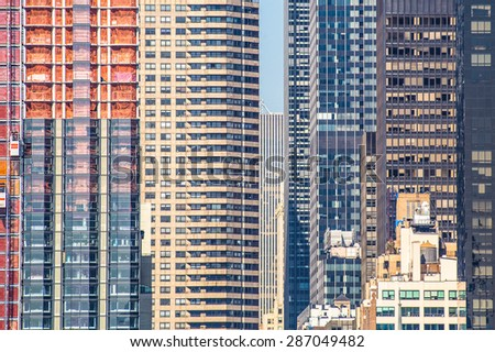NEW YORK CITY - SEPTEMBER 19, 2013:  Detailed view of many New York City skyscrapers with new construction visible.  - stock photo