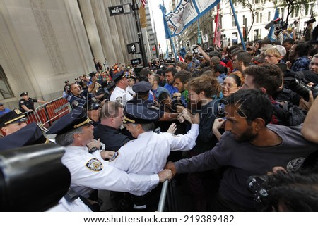 NEW YORK CITY - SEPTEMBER 22 2014: Flood Wall Street demonstrators marched from Battery Park to Broadway & Morris St where they staged a sit in before moving on to Wall St where NYPD made many arrests - stock photo