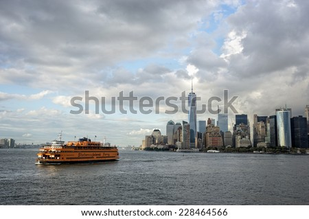 NEW YORK CITY - SEPTEMBER 16: Manhattan and the Staten Island ferry.  September 16, 2014, in New York City, USA. The Ferry is a municipal service since 1905 and carries over 21 million people by year  - stock photo
