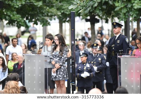 NEW YORK CITY - SEPTEMBER 11 2015: Memorial services were held at Ground Zero to mark the 14th anniversary of the World Trade Center attacks. 911 family reading names - stock photo