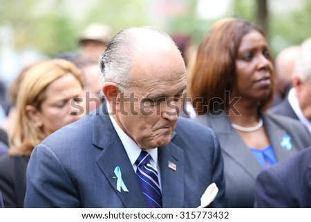 NEW YORK CITY - SEPTEMBER 11 2015: Memorial services were held at Ground Zero to mark the 14th anniversary of the World Trade Center attacks. Former NYC mayor Rudy Giuliani during moment of silence - stock photo