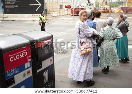new york city, 11 september 2015: mennonite girls in traditionel dress on the street in new york city near ground zero - stock photo