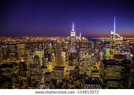 NEW YORK CITY - SEPTEMBER 15, 2015:  New York City skyline view across midtown Manhattan at night with lights